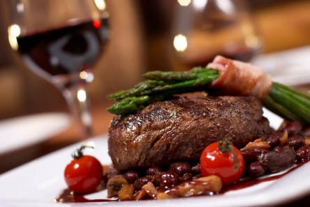 grilled beef with asparagus and a glass of wine