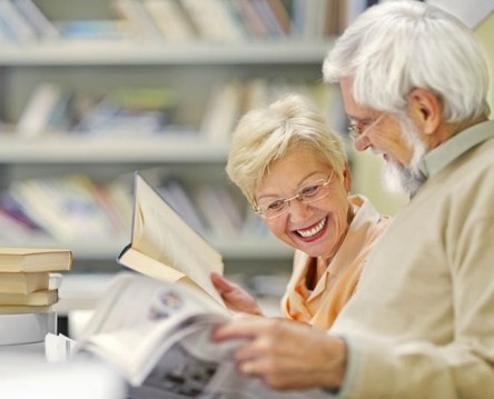 Senior couple in coffee shop have fun and reading