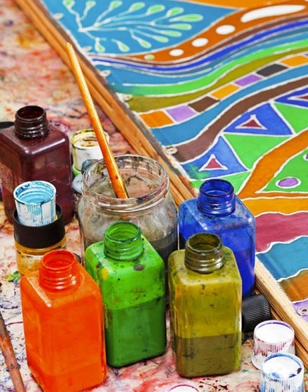 paintbrushes and bottles with pigments