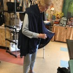 Margaret trying on a beautiful navy poncho.
