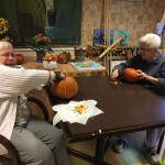 Edith couldn't wait to get her hands in that pumpkin!! She was a trooper!