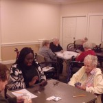 The residents are teaching Chermeine, our new Community Life Associate how to play 500 Rummy.