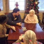 Our new Maintenance Assistant John, is playing Uno with the residents right in front of the toasty fireplace.