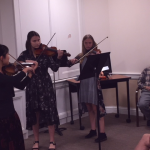 (Left to right) Yuri, Kara, and Ella playing happy birthday for Arthur.