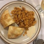 Empanadas with a side of rice & beans and a creamy bechamel sauce.